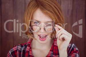 beautiful hipster woman winking at the camera