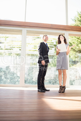 Real-estate agent showing young woman new home