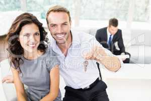 Happy young couple holding new house key