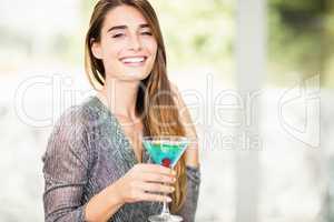 Portrait of beautiful woman having mocktail