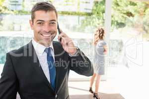 Real-estate agent talking on the mobile phone