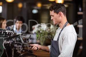 Barista making coffee with coffee machine