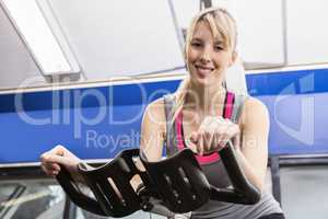 Fit woman on exercise bike