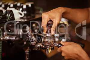 Close-up of barista preparing coffee