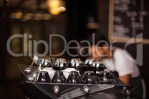 Cups on coffee machine
