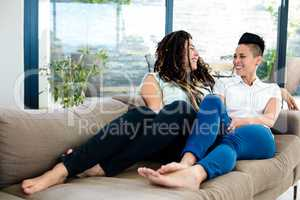 Lesbian couple smiling and talking to each other