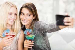 Beautiful women taking selfie with mobile phone