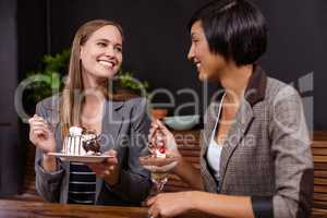 Pretty women eating desserts