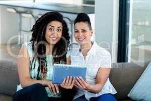 Lesbian couple using digital tablet