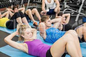 Group of people working their abs