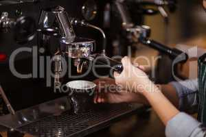 Close up of barista using coffee machine