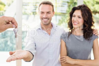 Real-estate agent giving keys