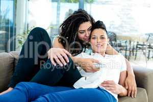 Lesbian couple watching television