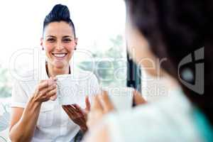 Lesbian couple having a cup of coffee
