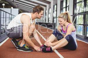 Muscular woman having an ankle injury