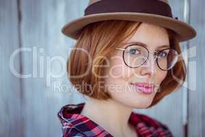 up close portrait of a smiling hipster woman