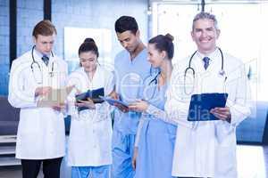 Doctors examining medical report