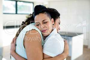 Lesbian couple embracing each other
