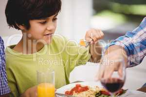 Boy having a meal at dining table