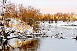 River and snowy waterside