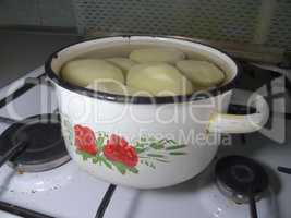 pan of potatoes on the gas stove