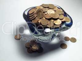 Vase of trifle, beautiful shadow, scattered coins