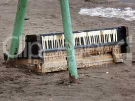 The broken piano keyboard, thrown in the yard