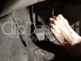 barefoot foot on the brake pedal
