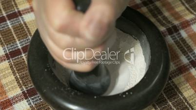 The grinding of the eggshell using mortar