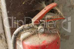 Old dusty fire extinguisher.