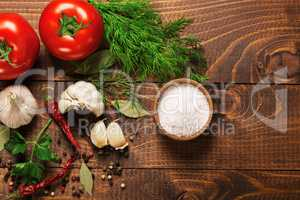 Pepper and tomatoes with garlic on a vintage wooden table