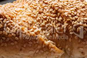 Loaf with sesame seeds background