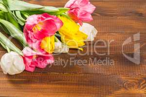 Bouquet Of Tulips In Front Of Spring Scene On The Wooden Background. A bouquet of flowers for March 8, or Valentine's day