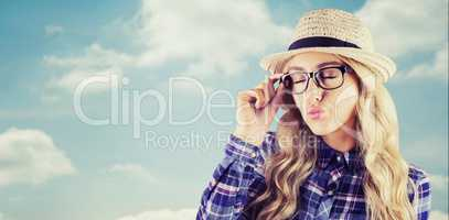 Composite image of gorgeous blonde hipster sending air kiss