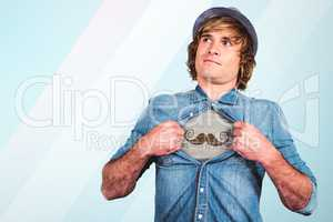 Composite image of funny blond hipster taking off his shirt