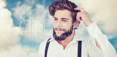 Composite image of hipster scratching head while thinking