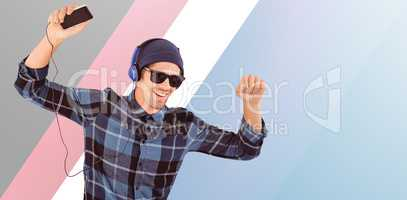 Composite image of happy hipster wearing headphones enjoying mus