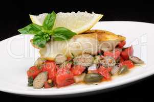 slice of baked fish perch with vegetables