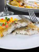 Slices of baked fish Dorado