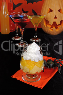 Dessert of pineapple and orange whipped cream