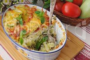 casserole of pasta with zucchini and tomato , cheese