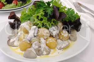 Balls potatoes with mushrooms and cream sauce