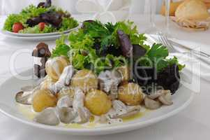 Balls potatoes with mushrooms and cream sauce in lettuce leaves