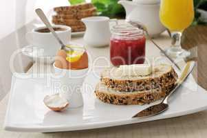 Breakfast with soft-boiled egg and slices of oatmeal bread