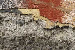 Close up of crumbling  wall with layers of peeled paint 9