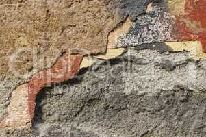 Close up of crumbling  wall with layers of peeled paint 1