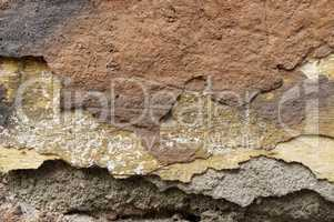 Close up of crumbling  wall with layers of peeled paint 7