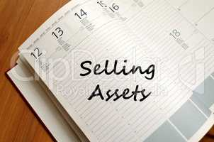 Selling assets write on notebook