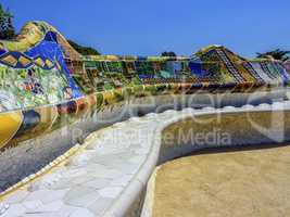 Ceramic bench at the Parc Guell designed by Antoni Gaudi, Barcelona, Spain.