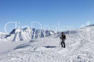 Skier on top of ski slope at nice morning